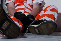 orange_white_1231 (skinmate) Tags: uniform prison jail jumpsuit inmate restraints legirons