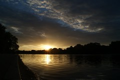 serpentine sunset (Ali Catterall) Tags: park camera bridge light sunset england sun sunlight lake reflection london water pool beautiful birds clouds wow photo fantastic twilight flickr pretty peace shadows view image dusk gorgeous awesome picture ducks tags grace calm swans stunning data hydepark ripples kensingtongardens incredible dappled heavenly breathtaking serpentine kensingtonandchelsea heatwaves gracefulness alicatterall sonydslra230