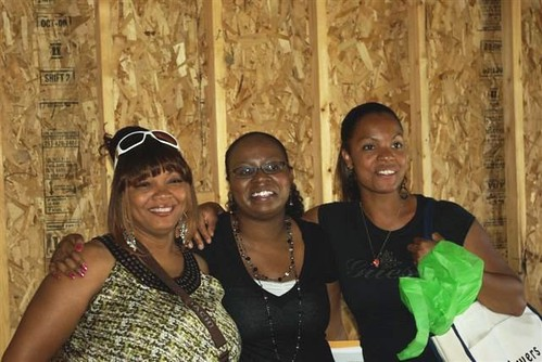 "(From left) Carol Daniel, Jessica Jackson, housing counselor for YouthBuild McLean County and Natalie Powers are all smiles as Daniel and Powers begin moving into their new ""green"" homes in Carlock, Ill."