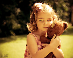 Intense love does not measure, it just gives. (Rebecca812) Tags: bear trees portrait cute girl beautiful grass children toy outside kid eyes hands hug pretty child play dress serious sweet daughter curls security lips teddybear pigtail canon5dmarkii familygetty2010 rebecca812