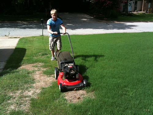 Alexander mowing the yard for the first time