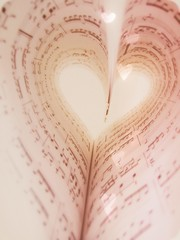 *25/365...I love music~ (E.B. Photography) Tags: original music cute love smart soft arty heart artistic bokeh sony creative 365 sheetmusic inspiring clever softlight lovable softtones musicnotes pinktones project365 ilovemusic 365project bookheart bokehhearts sonydsct90