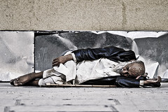 Sleeping on the street [EXPLORED] (Faisal AlKhudairy \   ) Tags: road street sleeping man men canon photography eos 50mm photo focus sleep walk poor sigma 7d l usm 18 1020 f28 f4  faisal needy 70200mm           1855m   70200m  400d                alkhudairy