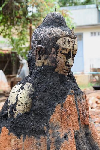 Bronze casting emerging Buddha