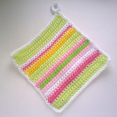 Grnrandig grytlapp. (TM - the crocheteer!) Tags: pink green pastel crochet rosa craft tm striped potholder croche randig grn hkeln virka virkkaus virkat hekling towemy uncinetto pistachiogreen virkad grytlapp virkata tmcrocheteer
