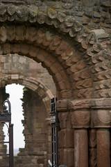 Curve I - Lindisfarne (Lawrence OP) Tags: greatbritain england stone arch medieval norman monastery romanesque monasterio zigzag monastere lindisfarne priory kloster monastero romanico mosteiro monestir chevrons romanisch prieure klaster klasztor artroman