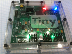 A V3 TinyG board in an laser cut plexiglass enclosure.