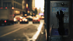 The phone booth. (Beat.) Tags: street nyc summer sun sunlight ny newyork blur streets lights evening blurry call dof phone traffic bokeh phonebooth cab taxi dial communication cents cabs telephonebox goldenhour telephonebooth callbox eveninglight longdistance goldenlight