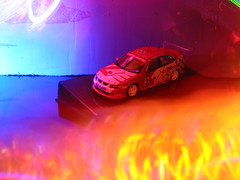 1:43rd Scale Honden Touring Car (sixty8panther) Tags: 2005 2003 door 2001 blue 2002 red orange lightpainting macro classic cars 2004 scale car yellow closeup race racecar sedan emblem logo toy toys four model gm aqua redwhite small models lion violet surreal 2006 commodore touring holden monaro 2007 143 generalmotors touringcar rwd straightoutofthecamera mobil1 143rd sooc holdencommodore gmaustralia holdenracecar