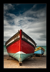 Fishing boat... (Chantal Steyn) Tags: ocean blue light red sea sky seascape beach sunshine clouds landscape southafrica coast boat fishing nikon filters fishingboat turqoise westerncape d300 arniston polarizingfilter nohdr waenhuiskrans 1685mm wagenhuyskrantz ndgraduatingfilter