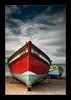 Fishing boat... (Chantal Steyn) Tags: ocean blue light red sea sky seascape beach sunshine clouds landscape southafrica coast boat fishing nikon filters fishingboat turqoise westerncape d300 arniston polarizingfilter nohdr waenhuiskrans 1685mm wagenhuyskrantz ndgraduatingfilter