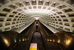 Archives-Navy Memorial-Penn Quarter Metro Station (Eric Spiegel) Tags: city urban color station architecture digital train underground subway concrete washingtondc dc publictransit metro geometry interior curves escalator shapes rail wideangle tunnel symmetry tokina transportation transit repetition dcist masstransit ultrawide metrorail brutalism brutalist metrostation wmata railstation nikond80