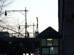 Balancing Act (Roblawol) Tags: nyc newyorkcity sculpture streetlamps manhattan walkway pedestrians upperwestside columbiauniversity amsterdamave baretrees uws february2011