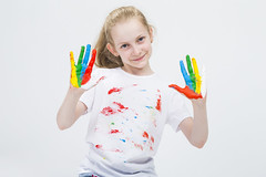 Smiling Active Caucasian Young Girl With Messy Colorful Palms While Making Handprints On T-Shirt With Fresh Paint. Against White Background. (DmitryMorgan) Tags: 1 711years active againstwhite artist artistic arty caucasian cheerful child childhood color colorful colour concept craft creative creativity daughter drawing education female fingers fun gouache hand happy kid little messy multicolor one paint painter palms people playful pleasure positive preschooler smiling tshirt young