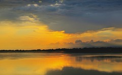 Stormy Sunset (Bobby Mou) Tags: hdr weather nature scenic storm yellow glowing clouds sunset lake water landscape
