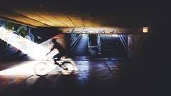 Rushing Through the Ugliness (karolklaczynski) Tags: fuji fujifilm xt1 wroclaw polska poland tunnel undeground passage street streetshooter streetphotography bike biker rush rushing people one light beam contrast urban space man candid city