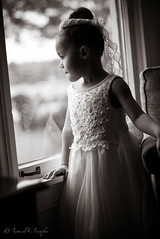 A Silent Gaze Through the Glass (Proleshi) Tags: wedding portrait blackandwhite window girl sepia standing 50mm daylight child think dressedup thinking desaturated grayscale ponder refection contemplation windowlight d60 50mm14afs proleshi