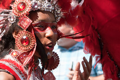 Woman in red (Daniel Durrans) Tags: carnival red woman girl face bristol person costume feathers feather stpauls makeup jewels jewel 2010 stpaulscarnival ddfl ddpf