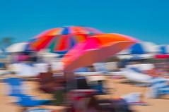 At the Beach - 131 (cbonney) Tags: blue summer sky beach virginia sand umbrellas