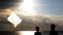 Kid's Kite (Biplob Sarker) Tags: sun kite silhouette kids clouds canon river flying flare shining bangladesh