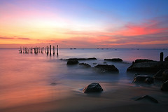 Broken Pier [Explored] (Randi Ang) Tags: longexposure sunset seascape beach canon indonesia landscape eos pier twilight rocks jetty 5d lombok waterscape ntb ampenan westnusatenggara nusatenggarabarat exharbor