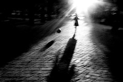 (Donato Buccella / sibemolle) Tags: park street blackandwhite bw parco blur milan backlight ball children play milano streetphotography flare santagostino parcosolari canon400d sibemolle 4926n2 mg4933