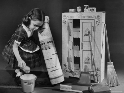 vintage image of girl with toy housekeeping set
