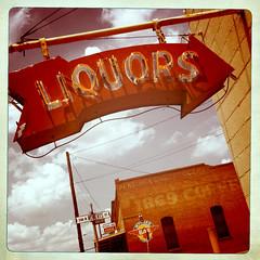 Neon Sign West Texas Liquors Arrow IMG_1603 (Dallas Photoworks) Tags: street west building brick coffee sign bar neon texas liquors 1869 roberst myners
