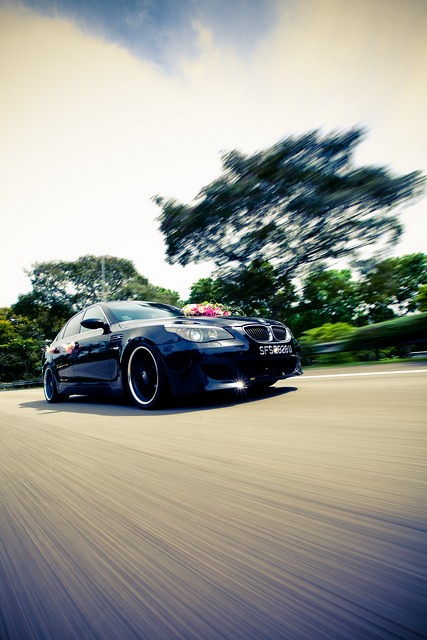 Raymond Phang Photography - signature motion car shot on actual day wedding