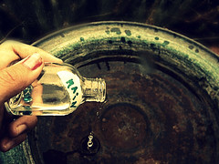(Regan Norton) Tags: green water glass rain yellow jar pour pouring
