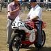 Ron Chandler on his vintage BSA race bike talking to Dennis Bates