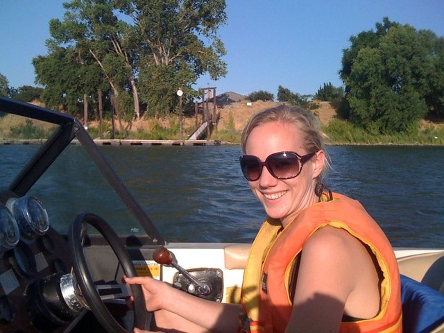 Monica driving the ski boat
