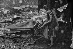 Typhoon Esther in Ulingan (charcoal) , Tondo, Manila - Working in the storm (Mio Cade) Tags: life boy portrait storm water rain kid factory child flood humanity philippines social charcoal disaster manila damage environment esther typhoo tondo ulingan