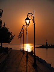 illuMiNaTiOn -  ( BrOnZe ) !  (Ilias Orfanos) Tags: park sunset sea sky marina lights photo creative olympus best greece lamps
