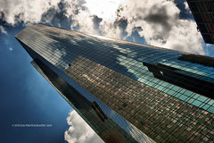 I WANNA BE BIG (ANVAR - RUSSIANTEXAN ) Tags: blue sky reflection glass clouds skyscraper nikon downtown texas steel tx houston wellsfargo russiantexan anvar dynegy d700 khodzhaev anvarkhodzhaev russiantexas svetan svetanphotography