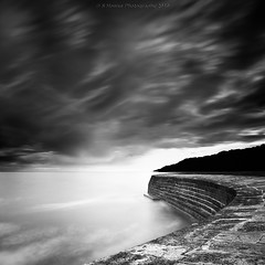 Sundown At The Cobb (Scott Howse) Tags: ocean longexposure sea england sky blackandwhite bw cloud water monochrome lee dorset filters lymeregis graduated thecobb harbourwall nd110 09h