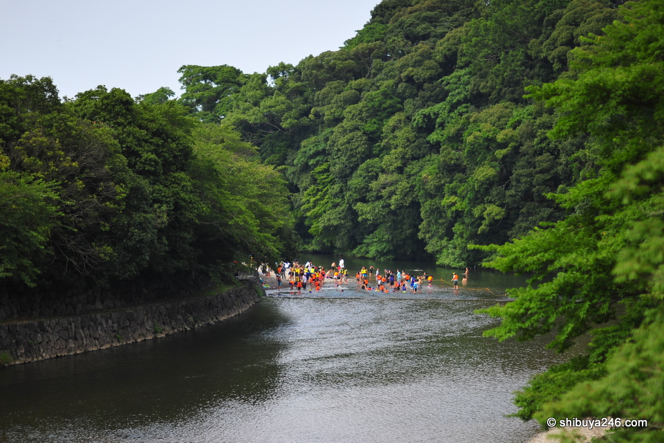 Back in the main river, a group of people were enjoying the cool water
