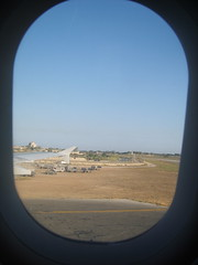 malta international airport (I Am Kati) Tags: road holiday church window airplane flying airport view wing ground malta aeroplane goodbye cracked