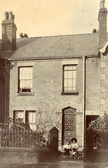 Two children and a toy horse outside the house (lovedaylemon) Tags: old house facade vintage children toy found terrace passage edwardian owners occupiers