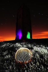 Glastonbury dome (AndWhyNot) Tags: light green tower monument st night painting star ancient long exposure purple painted trails glastonbury pollution dome tor michaels startrails 9563