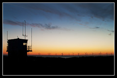 dawn at the coast (SFB579 Namaste) Tags: light sunset sea sun nature water set sunrise dark fire coast candle wind great flame tall yarmouth windturbines silhoouette