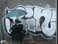 Urban Sophistication (indigo_jones) Tags: urban white black holland brick students netherlands rain contrast umbrella graffiti utrecht nederland regen paraplu unitas sophistication ontgroening morningsuits
