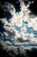 skylines (lomoD.xx) Tags: blue sky london skyline clouds lomo lca xpro crossprocessed xprocess fluffy lomolca pylon lookingup electricity 100 pylons jessops100asaslidefilm agfaprecisa 100asa eastend agfaprecisa100 jessops bzzzzz lomodxx precisa omo precisa100 secretrobots neckcreaker lomodxxwall