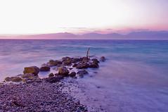 A view in the Corinthian Gulf (n.pantazis) Tags: longexposure red sea sky beach rock rocks glue magenta shore peloponnese pentaxkx akrata peloponnisos korinthiakos 5sec roumeli corinthiangulf dal1855