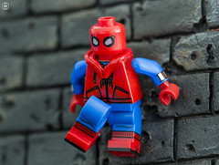 Spider-Man Homecoming (jezbags) Tags: lego legos toys toy minifigure minifigures macro macrophotography macrodreams macrolego canon60d canon 60d 100mm closeup upclose spiderman wall marvel marvelstudios homecoming suit red blue stone