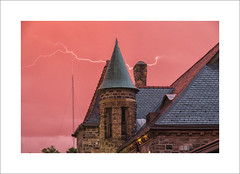 Lightning (DJ Wolfman) Tags: lightning pink sky old trainstation roof electric michigan annarbor annarbormi michiganfavorites olympus olympusomd em5ii 14150mm zuiko zd