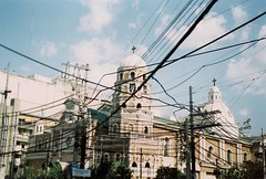 Through the Wire (Jose Mari Manio) Tags: philippines quiapo manila minolta srt film fujicolor c200 street filipino analog rokkor architecture church