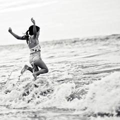 well now, you knew there'd be a jump shot (jamie {74}) Tags: ocean sea bw jump wave puntacana photooftheday featured nikond40 nikkor50mmf14g thematernallens ineedworkonprocessingrawphotosinlr