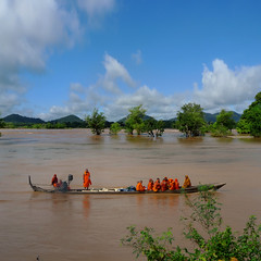 Monks on a slow boat at the Mekong River (B℮n) Tags: saffroncloakedmonksonaslowboat monksinaboat mekongriver neartheborderoflaoscambodia buddhisminlaos theravadaschool theteachingsofthebuddha recentmonkworkshop irrawaddydolphinandfishconservation unlimitedlybeliefonbuddhistreligion only64or65irrawaddydolphinsleft criticallyendangeredspecies mekongriverinsoutheastasia raisingawareness themonksencourageadialogue kratieandstungtrengprovinces helptheirrawaddydophinstosurvive mostpeopledonatefoodtothemonks rainyseason monsoonseason sunsetonthemekong riverdolphin downstreamkratiecambodia 50faves topf50 100faves topf100