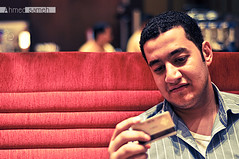Somebody ... (Ahmed Sameh) Tags: red night 50mm cafe nikon saudi arabia jeddah f18 d90 cilentro